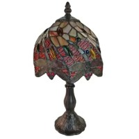 This table lamp features handcrafted glass created in rich jewel tones. Made with stunning jewels and hand-cut pieces of glass, each wrapped in fine copper foil, this piece utilizes the technique developed in the early 1900s. Draw inspiration from glass windows when you place this sparkling table lamp in your living room or bedroom. This lamp is a good fit for most home decor themes. Shade colors will appear darker and less vibrant when not illuminated. The handcrafted nature of this product...