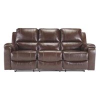 Once you recline in this dual reclining power sofa at the push of a button, you will not want to get up. It's that comfortable with bustle backs and padded ottomans. Its look is amazing with dramatic cut and sews lines, jumbo stitching and affordable mahogany leather match upholstery, which features top-grain leather in the seating areas with skillfully matched vinyl everywhere else—what a way to relax.