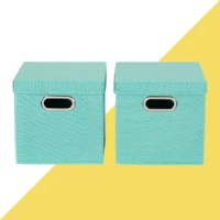 Clear clutter from your space without sacrificing style with this set of two storage cubes. Made with linen fabric, each piece strikes a boxy silhouette measuring 11'' H x 11'' W x 11'' D, so they're sized to hold papers, office supplies, toiletries, and more. Lift-up lids help conceal odds and ends tucked inside, while metal grommet handles make it easy to move items between rooms. Beyond functional, they feature a bright solid hue for a splash of color.