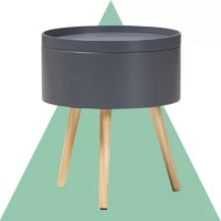 Bring retro modern flair to your bedside with this mid-century nightstand! Crafted of pine and manufactured wood in a matte painted finish, this nightstand strikes a cylindrical silhouette on three natural wood flared legs. Its tray tabletop is great for corralling your alarm clock and phone charger, while hidden storage space beneath is perfect for stowing for other bedside essentials. Measuring 18