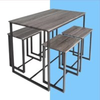 Bring a taste of what's trending to your entertainment ensemble with this five-piece pub table set. The perfect pick for small spaces, this set includes one rectangular table with four backless bar stools that slide easily underneath to save square footage when they're not in use. On-trend and on-budget, each piece is crafted with an open, angular metal frame and a manufactured wood top in a neutral gray stain for an understated look.