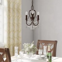 With upholstered chairs pulled up, a Persian-inspired rug as your fine foundation, and table settings dressed up to the nines, your breakfast nook is bold and beautiful. The only thing missing? A lovely luminary! Finish off the ever elegant ensemble by stringing up this chic chandelier overhead for a warm and inviting glow. While your succulent roast chicken and garden-fresh salad are sure to delight dinner party guests, this alluring light's look might just steal the show. Crafted of metal...