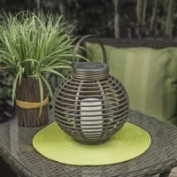 This basket-style lantern gives your outdoor spaces a fun look. Made of durable brown plastic that withstands weather, our lantern features a flickering amber LED flameless candle for a true candlelight experience. Runs on 1 AA 300mAh NiMh battery.