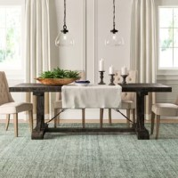 Mix a dash of modern farmhouse flair into your dining room or eat-in kitchen with this rustic dining table. It's built on top of a traditional trestle base, and its rectangular top is complete with an 18