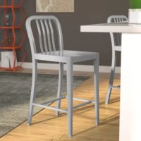 Whether rounding out the kitchen island or pulled up to a pub table, this bar stool is always a stylish spot to sit in your entertaining space. Crafted from galvanized steel, its frame is founded atop four legs connected by supports where you can rest your feet. Its silhouette is traditional with a rounded and slatted back, while a solid finish keeps it versatile.