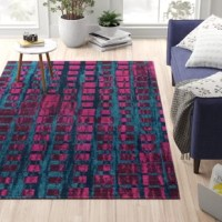 Set a mod foundation for your space with this purple area rug, showcasing a mid-century geometric square motif. Made in Turkey, this area rug is power loomed from stain- and fade-resistant polypropylene in a low 0.4