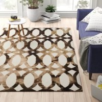 Introduce an interplay of color and texture into any ensemble with an area rug. This design, for example, features an interlocking geometric motif in a watercolor-inspired pattern for a striking look that's sure to grab glances. Crafted from cotton and wool, it features a 0.63'' pile height that stands up to the high traffic of busy areas such as the living room or entryway. No matter where this item ends up, we recommend pairing it with a rug pad.