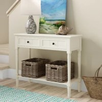 What's the first thing guests see when they walk into your entryway? With this console table by the front door, they'll be greeted by the warm glow of a lamp, a cluster of potted greenery, or maybe even your own custom art pieces. No matter what you choose to display, this piece is the perfect pick. A true traditional, its solid pine wood frame features four turned legs and drawer fronts with carved details.