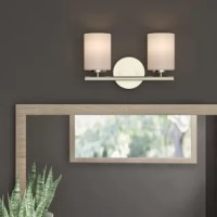 Designed to live in damp spaces, this understated vanity light introduces a touch of contemporary style as it boosts the brightness of your bathroom. Crafted from steel, this fixture features a round backplate and a clean-lined horizontal rod that supports a pair of compatible 100 W medium-base bulbs (not included). Cylindrical glass shades in an etched white hue complete the laid-back look. The manufacturer backs this product with a one-year warranty.