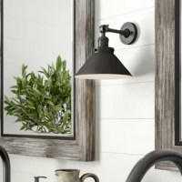 Bring some brightness to a modern farmhouse space with this vanity light. Crafted from cast brass, it features a circular backplate and a horizontal bar that showcases a cone-shaped shade with a swivel function to help you direct light exactly where you need it, making it perfect for getting ready in the morning. This luminary accommodates 100 W maximum bulbs (not included). We recommend you pair an Edison bulb with it to introduce even more vintage-inspired appeal.