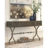 This Console Table is style with a purpose. This casual look flaunts a medallion pattern along the front. Champagne color finished metal complements the antiqued gray-finished wood. Rest assured x-base is as strong as it looks. Functional drawer allows you to keep knick-knacks out of sight.