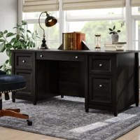 Blending form with function, this 29'' H x 65'' W x 29'' D executive desk makes the perfect pick for your home office. Crafted from manufactured wood in a black hue, it showcases a traditional look. Two file drawers glide on smooth ball-bearing slides to hold letter-size documents, while two box drawers organize miscellaneous supplies so your workspace remains uncluttered. A center keyboard tray folds down for easy access.