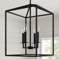 This small four-light lantern in a black finish is inspired by elegant carriage lanterns. The updated open frame is formed with sleek square steel tubing, and each chandelier is generously proportioned with a minimalist silhouette. A candelabra style bulb is a great addition to add a warm glow to your hallway or foyer, yet it can also be an ideal focal point on a covered patio or porch.