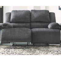 Large-scale comfort is yours with the reclining power loveseat. With supremely padded back, seat and arm cushions, it's the hero for ultimate relaxation. Microfiber upholstery is welcoming, soft and luxuriously covers the extra-wide seats. Recline back and kick up your feet to bolster your comfort level even more.