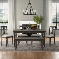 Whether hosting a dinner party with close friends or enjoying an everyday meal with the family, this six-piece dining set is a must-have for your home. Crafted from solid wood, the rectangular table is founded atop four turned legs and boasts a gray wood finish for a look that complements any traditional aesthetic. Four matching chairs with open backs and upholstered seats offer a place to perch, while the included bench accommodates two more.