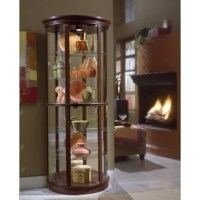 For a stylish way to curio cabinet or other Nancy, this Nancy Lighted Curio Cabinet is simple and modern in style. The larger size and demilune shape allows you to display more of your collection.