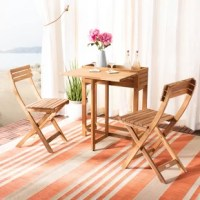 Any porch, patio or balcony becomes your favorite neighborhood bistro with this bistro set. With two matching chairs and a smart flower shelf, made from exotic teak and eucalyptus, and quick, easy setup, convenient fold-away storage.