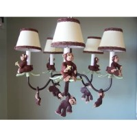 A really cute chandelier that will look great with many of the safari themed bedding setsor a monkey themed room.This brown chandelierhas a handmade monkey sittingatop green palm tree leaves on eacharm.There are 6 spear shaped crystals hanging on the ends of eachpalm. More monkeys are just