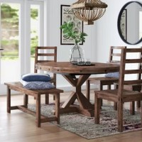 Create a compelling and cohesive aesthetic in your arrangement with this dining set – which includes one table, one bench and four chairs. Crafted from mahogany wood, the table is perched atop a pedestal base and boasts a circular silhouette with exposed bolt detailing, working well in a variety of aesthetics. Each fullback seat showcases a slatted design, while the bench is constructed to support up to 400 lbs. Plus, this product is backed by a one-year warranty.