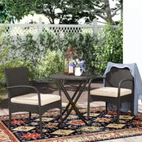Perfect for petite patios, this three-piece bistro set includes one round table and two arm chairs so you can sit back and soak up some sun beside a buddy. Designed to live outdoors, each piece is crafted with an iron frame and wrapped in polyethylene wicker in a neutral brown hue. Woven details give this set a breezy and approachable traditional look. Cream-colored cushions with removable polyester-blend covers top each seat to provide 1.96