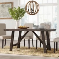 A fine fit for farm-fresh meals and pizza parties alike, this dining table creates a modern farmhouse-inspired aesthetic in your eating area. Founded atop four angled legs, its frame is crafted from solid acacia wood with a brown finish for a rustic look. This 66'' L x 36'' W x 30'' H dining table easily seats six and perfectly pairs with traditional or rustic chairs of your choice. Minimal assembly is required.