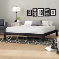 Set a modern and minimalist foundation in your restful retreat with this clean-lined platform bed frame. Crafted from metal, this low-profile piece features a system of slats to prop up your preferred mattress without the help of a box spring. Neutral black finish outfits this design, ensuring it can complement any color palette you dream up. Assembly is required. The manufacturer backs this product with a five-year limited warranty.