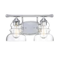 Whether you're remodeling your master bath or just looking to punch up the powder room, this two-light vanity is sure to do the trick. This vanity light is crafted from metal, featuring a round backplate and top arm that showcases two downward-facing clear glass bell shades surrounding 100 W bulbs, which are not included. Installation is required for this hardwired luminary. Plus, it's rated for wet areas, perfect for bathrooms with steamy showers.