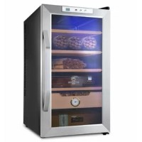 Store your cigar at the ideal temperature and relative humidity level with the cigar cooler. This freestanding cooler features precise temperature controls and an easily monitored hygrometer. More than just a refrigerator and more efficient than a humidor, this model is airtight to lock in the desired environment while locking out the light. Premium Spanish cedar shelves encourage humidity regulation while preventing the development of cigar beetles. Breathe easy and know the condition of your...