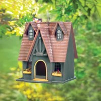 Do you enjoy watching feathered friends fly through your garden? Why not give them a cozy and stylish home with this eye-catching birdhouse. Showcasing a metal loop hanger, windows for healthy airflow circulation, a spacious door, brown and green finish, and a charming wood cottage design, this birdhouse is sure to delight you and your neighborhood birds. Set it in your blooming garden, then add a comfortable wicker chair for the perfect place to watch birds and take in the beauty of nature. Or...