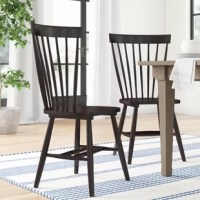 When it comes to rounding out your dining ensemble, the chairs you select to do more than let you draw up to the table for a meal – they're also important elements of style! Take these chairs, for example: crafted from solid oak, they showcase a squared Windsor back for a look at the intersection of schoolhouse and cottage style. Perfect for giving a room a country touch, making this set of two chairs a great option for standard table heights.