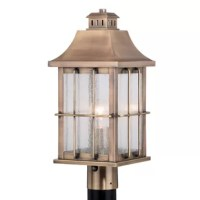 The Quincy collection is made of solid brass and will stand the test of time in coastal areas or places with severe weather. Quality brass construction equates to rust-proof and durable long lasting fixtures. Traditional beauty is at its finest in the Quincy outdoor collection. Warm tones of antique brass highlight the simple sweeping lines of the lantern shaped fixtures. Clear seeded glass panes are accentuated with a grid like trim to add an old-world charm. Dusk to dawn photo cell...