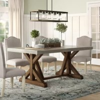 Your dining table is a centerpiece for your home, and not just because it's the anchor of your dining room ensemble: it's also important for gathering your family and friends around a meal. So settle in with rustic-inspired style with a piece like this: crafted from a base of solid and manufactured wood, it's capped with a concrete surface for an on-trend mixed material look. A trestle style base rounds this piece out with additional style perfect for a modern farmhouse. This table comfortably...