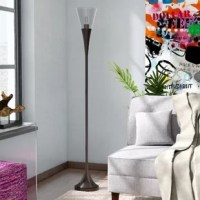This torchiere standing lamp combines the natural elements of a seeded glass shade for a clean but organic aesthetic.