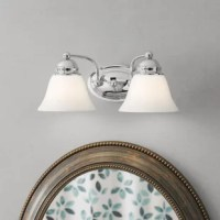 Designed to live in damp areas while still staying decorative, this vanity light is essential for making your powder room shine. Crafted from metal, its frame features an oval-shaped back plate connecting to two curved arms spanning 14.88