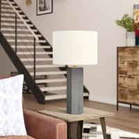 The handsome Settles 29'' Table Lamp conveys a contemporary and modern aesthetic. The bold gray hexagonal body isn't afraid to flaunt its magnificent style, and the brushed brass finish that peeks from in and around the white linen shade accentuates its stately form.