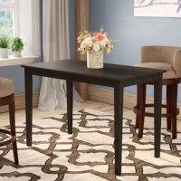 This sleek dining table might be big on style, but its petite scale is ideally suited for small spaces. Dark finish and minimalist design make this table the epitome of contemporary decor.