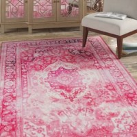 The old world antique inspired style is modernized with the distressed details of this Blair Pink Area Rug. When it comes to color, the sky is no longer the limit with the infinite possibilities of this collection. Perfect in any room from a modern bedroom to a trendy nursery or kid's room. Thoughtfully crafted in the U.S.A. in small batches utilizing exclusive precision dye injected printer, this collection is redefining printed rugs, literally one original design at a time. Created on a plush...