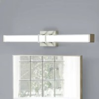 This Jambi 1-Light LED Bath Bar brightens any room with its striking contemporary design. Featuring two metal arms that wrap around and are centered on a frosted glass light bar, it provides ample illumination from the integrated bright warm white LED bulb.