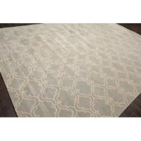 This is a beautiful Nita Hand-Tufted Wool Gray Area Rug. Its elegant style is easy to decorate with and perfect for living room, dining room, bedroom or anywhere in the residence or office