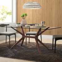 Your dining table is the spot where you and your family will sit down to share a meal, so it should deliver the perfect blend of on-trend style and plentiful space. Take this table, for example: perfect for a mid-century-inspired touch, it features a tempered glass surface founded on angled legs crafted from solid beechwood. Measuring 71'' L x 35.5'' W x 29.5'' H, this table is perfect for seating up to eight people in sleek style.