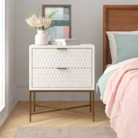 Whether sitting beside your bed or acting as an end table in the living room, this nightstand is always a stylish stage. Founded atop an open metal frame in a stylish golden hue with an X-shaped design, it takes on a contemporary clean-lined silhouette with a neutral white hue that's sure to blend in with any color palette. Measuring 28'' H x 24'' W x 16'' D, this low-profile design includes two drawers with textured finishes perfect for hosting before-bed essentials.