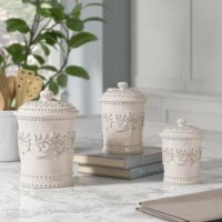 An elegant, vine-patterned earthenware set that includes three lidded canisters. This beautiful canister set is made of thick, high quality, a lead-free ceramic that will last for years to come. An easy way to add a unique and chic touch to your kitchen or countertop. The 3 piece set is wonderful for use as cookie jars, kitchen storage, baking supply bins, coffee and tea holders, etc. Or give it a great hostess gift. The ideal complement to any kitchen or home, these canisters come in three...