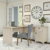 Keep clutter out of sight and out of mind in your office ensemble while lending a touch of traditional charm using this desk as a centerpiece. Crafted from wood, it strikes an L-shaped silhouette – perfect for fitting in the corner of any room – and boasts a solid neutral finish for a look that complements nearly any color palette. Plus, it includes one box drawer and cabinet for keeping office essentials at arm's reach.