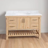 Finalize your bathroom remodel in style with this 48'' W single vanity set. Crafted from solid fir wood and finished in a driftwood look, this piece showcases a traditional look perfect for industrial aesthetics. A slab of white Carrara marble rounds out the piece up top, as well as three pre-drilled holes for a faucet of your choice, and one ceramic undermount sink. When it comes to storage, this vanity is equipped with four drawers, a cabinet, and an open lower shelf perfect for stacking...