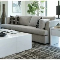 Add a relaxing vibe to your living room decor. This stylish sofa exudes simple comfort and subtle glamour. Soft, gray upholstery gives it a thoroughly pleasing texture. Plush back, seat, and side cushions offer hours of cozy relaxation. Topped off with the eye-catching pattern of its 2 accent pillows, this sofa updates any living room with casual style.