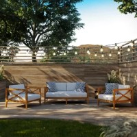 Soak in nature's majesty as you relax with this outdoor sofa seating group. Create your best memories as you lounge with a series featuring configurations customizable for your space. Ideal for balconies, backyards, patios, gazebos, poolside or garden. This collection features all-weather UV resistant cushions and a unique cross-back design for added support and aesthetic appeal. Teak is known for solid construction and the ability to withstand weather extremes and is the wood selection of...