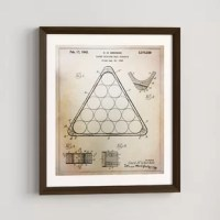 When it comes to lending your space a fresh feeling, sometimes there's no need to spend all of your energy swapping out big pieces of furniture: sometimes all it takes is swapping out your wall art! Take this print, for example: perfect for a vintage-inspired touch on your walls, this piece features a blueprint-style diagram of a billiards triangle. Printed in the USA on paper, this piece arrives with a bronze-finished frame for a classic look. And since it includes wall mounting hardware, it's...