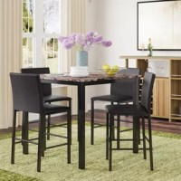 With a scale appropriate for any number of smaller dining spaces, the Noyes 5 Piece Counter Height Dining Set will provide the look and style you want in your home. The transitional feel of the group comes from the richly hued faux marble tabletop and the minimalistic design of the dark brown bi-cast vinyl chairs. The table and chair are constructed of metal in the black finish.