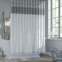 Bring style and function to your powder room in one fell swoop with this all-in-one shower curtain. A built-in liner repels water to keep your bathroom floors safe and splash-free, while a neutral-hued front panel showcases subtle stripes and textured accents for an understated and approachable look. Made from 100% polyester, this mildew- and fade-resistant piece is machine washable for easy upkeep (just remember to use a gentle cycle and let it line dry afterward). To hang it up, just slip a...