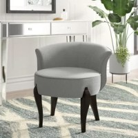 Inspired by old Hollywood dressing rooms, this glamorous vanity stool is a chic and sophisticated addition to any master suite. Founded on a solid wood frame, this dapper design strikes an updated Victorian silhouette with curvy, flared backrest, an armless, circular seat, and four cabriole legs in a sleek black finish Available in a curated selection of sophisticated hues, rich brushed linen upholstery ensconces the seat, accented by corded edges for a tailored touch, and cushioned with plush...
